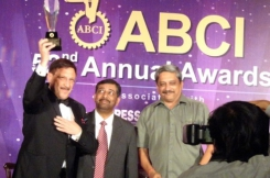 "Maxim Behar (left) received the ""Communicator of the Decade"" Award from the President of the Association of Business Communicators of India Yogesh Joshi and the Chief Minister of Goa Manohar Parrikar. Photo by M3 Communications Group, Inc."