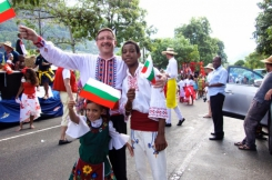 Maxim Behar, Martina and Steven dressed in Bulgarian costumes, carrying Bulgarian flags, at the 2014 Seychelles International Carnival of Victoria